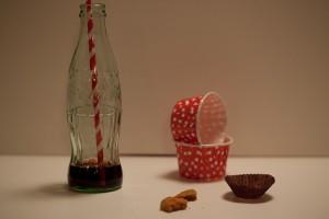 Coke bottle, cookie crumbs and stuff