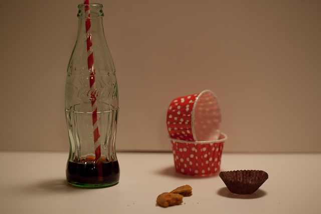 Coke bottle, cookie crumbs and stuff