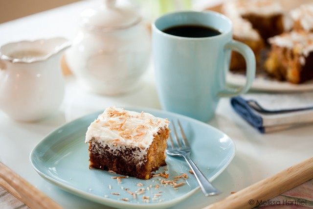 Carrot cake with tea by a bright window