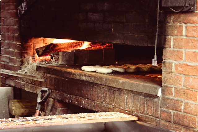 Bagels baking in a wood burning oven