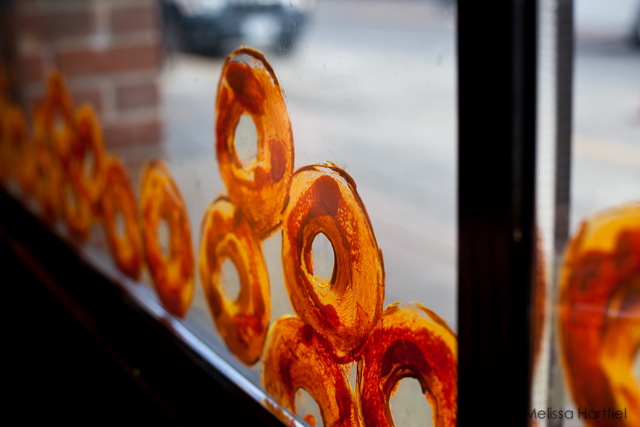 glass window with bagels painted on