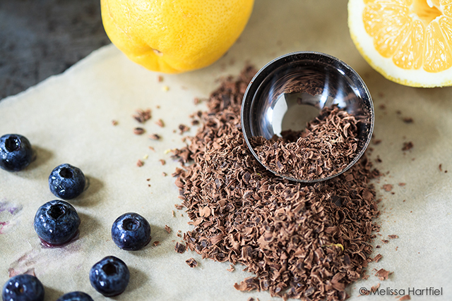 shaved chocolate with blueberries and lemons