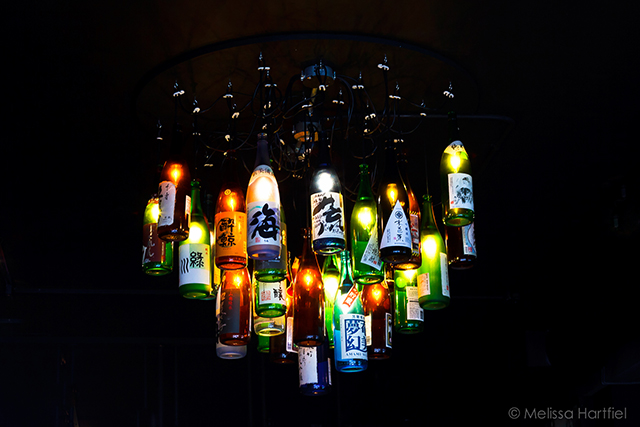 Chandelier made from old saki bottles