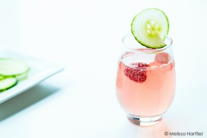 a pink cocktail with bubbles