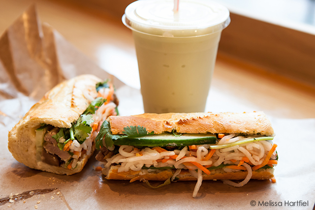 two banh mi and a honeydew smoothie