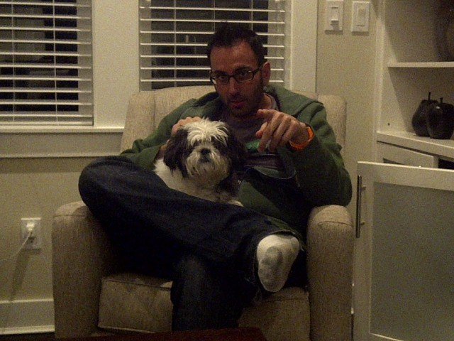 Ethan sitting with Toto the dog